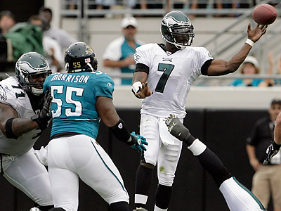 Michael Vick accounted for all four Eagles touchdowns, three by air and one on the ground. (Yong Kim/Staff Photographer)