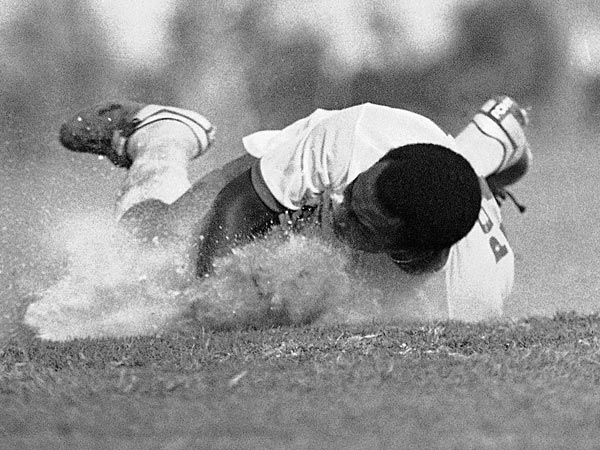 New York Cosmos soccer player Pele bites the dust during action against the Miami Toros in Miami on Sunday, April 19, 1976. The famed player got sand in his eye during the action and time out was called. The Cosmos weren´t slowed down at all and defeated the Toros 1-0 in the season opener. (AP Photo/PKS)