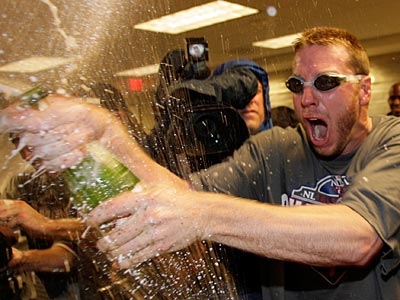 Roy Halladay celebrates after his 2-hit shutout clinched the Phillies´ fourth straight NL East title. (Yong Kim/Staff Photographer)