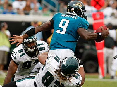 Darryl Tapp (No. (91) and Trevor Laws (No. 93) helped the defense hold David Garrard and the Jaguars to just 3 points. (Ron Cortes / Staff Photographer)