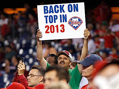A Phillies fans holds up a sign hoping for a better 2013. (Yong Kim/Staff Photographer)