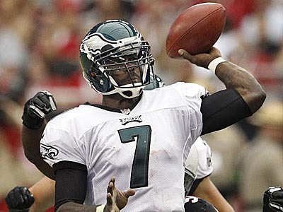 Michael Vick throws a passer under pressure. (Ron Cortes/Staff Photographer)