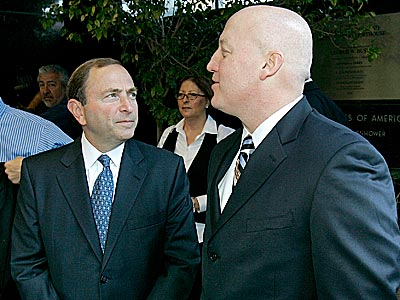Gary Bettman and Bill Daly will meet with the players union representatives Tuesday. (Matt York/AP file photo)