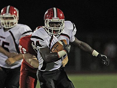 Kingsway running back Ray Lawery (24) carries for a first down. ( David M Warren/Staff Photographer)