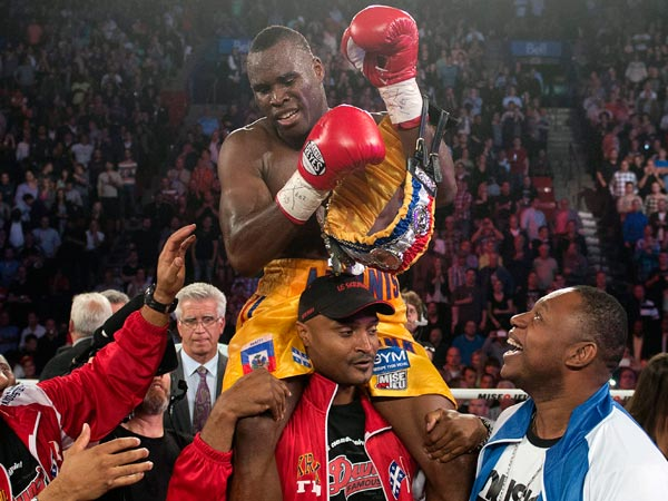 Adonis Stevenson, from Montreal, celebrates after defeating Tavoris<br />Cloud to defend his light heavyweight title in a boxing bout Saturday,<br />Sept. 28, 2013, in Montreal. (AP Photo/The Canadian Press, Ryan<br />Remiorz)