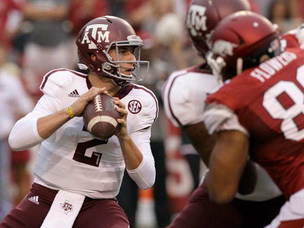 Texas A&M quarterback Johnny Manziel (2) looks for a receiver as he prepares to pass over Arkansas defensive end Trey Flowers (86) during the first quarter of an NCAA college football game in Fayetteville, Ark., Saturday, Sept. 28, 2013. (Danny Johnston/AP)