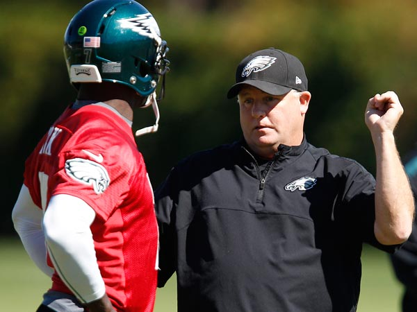 Eagles quarterback Michael Vick and head coach Chip Kelly. (David Maialetti/Staff Photographer)