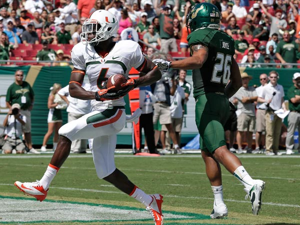 Miami wide receiver Herb Waters (6) pulls in a 19-yard touchdown after getting past South Florida safety Mark Joyce (26) during the first quarter of an NCAA college football game Saturday, Sept. 28, 2013, in Tampa, Fla. (Chris O´Meara/AP)
