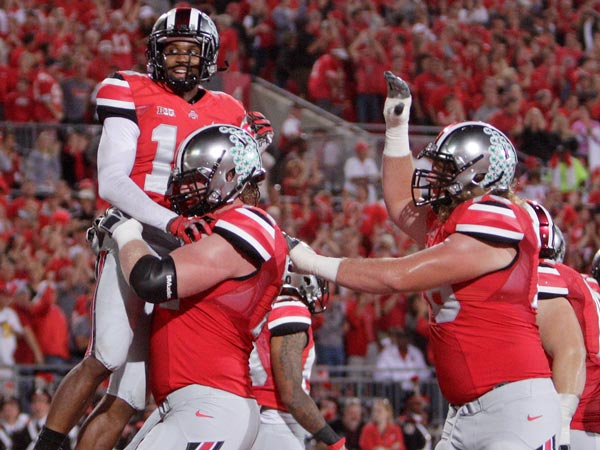 Ohio State wide receiver Corey Brown, top, celebrates his touchdown against Wisconsin with teammates during the second quarter of an NCAA college football game Saturday, Sept. 28, 2013, in Columbus, Ohio. (Jay LaPrete/AP)