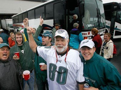As they prepare to head into the Eagles/Chiefs game, Ron Smith leads the bus in the Eagles chant. The group has been chartering buses to Eagles games for 50 years. (Charles Fox / Staff Photographer)