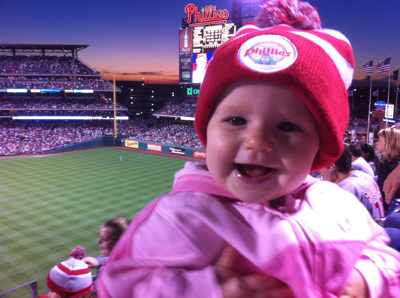 Emma Somogyi, 11 months, has already been to 17 games, met Roy Halladay and hugged the Phanatic.