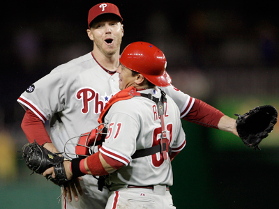 Roy Halladay celebrates with Carlos Ruiz after pitching a complete game shutout to clinch the NL East. (Yong Kim / Staff Photographer)