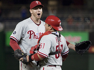 Roy Halladay celebrates with Carlos Ruiz after pitching a complete game shutout to clinch the NL East. (AP Photo/Evan Vucci)