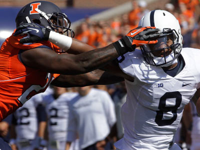 Penn State wide receiver Allen Robinson escapes Illinois defensive back Jack Ramsey on Saturday. (Seth Perlman/AP)