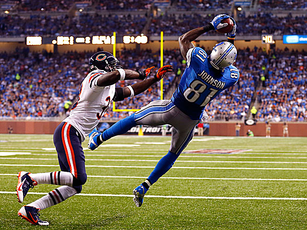 Lions wide receiver Calvin Johnson, defended by Bears cornerback Charles Tillman, catches a two-yard touchdown. (Jose Juarez/AP)