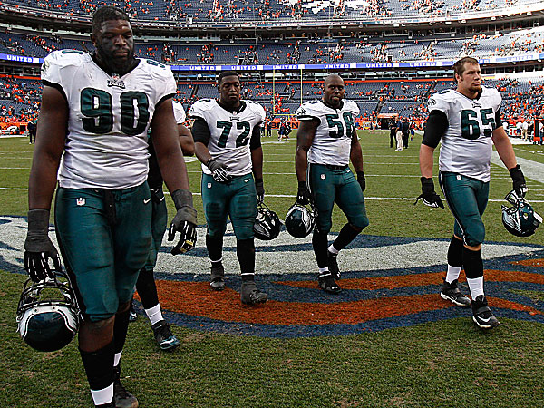 Eagles players leave the field after the loss to the Broncos. (David Maialetti/Staff Photographer)