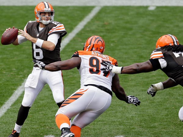 Browns quarterback Brian Hoyer (6) sets to pass under pressure from Cincinnati Bengals defensive tackle Geno Atkins (97) in the second quarter of an NFL football game on Sunday, Sept. 29, 2013, in Cleveland. (Tony Dejak/AP)