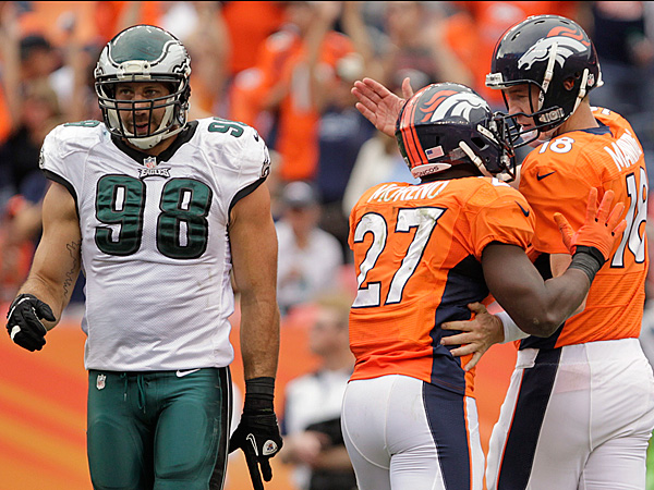 Denver Broncos quarterback Peyton Manning (18) and running back<br />Knowshon Moreno (27) celebrate a touchdown against the Eagles. (Joe<br />Mahoney/AP)