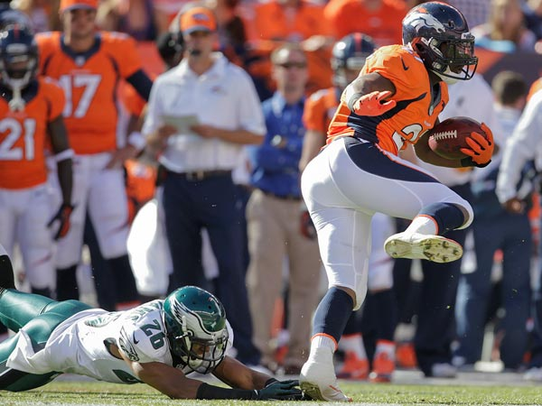 Broncos running back Knowshon Moreno (27) skips away from Philadelphia Eagles cornerback Cary Williams (26) in the second quarter of an NFL football game, Sunday, Sept. 29, 2013, in Denver. (Joe Mahoney/AP)