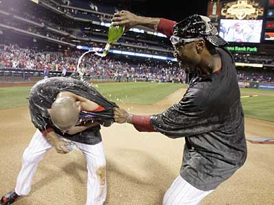 Jimmy Rollins pours champagne on teammate Shane Victorino following the Phillies´ clinching win against the Astros on Tuesday night. (Yong Kim / Staff Photographer)