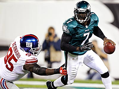 Against the Giants, Michael Vick got himself out of the pocket on a few occasions rather than hang around and get creamed. (Mel Evans/AP)