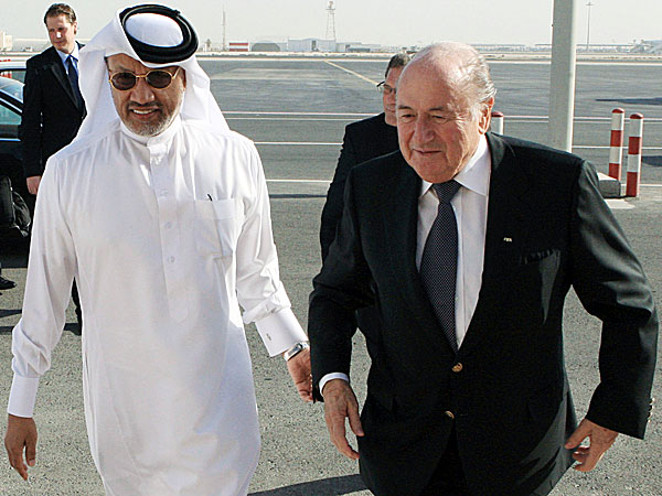 FIFA President Sepp Blatter is welcomed by AFC president Mohammed bin Hammam upon his arrival in Doha, Qatar in 2011. (Osama Faisal/AP file photo)