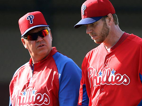Philadelphia Phillies pitcher Roy Halladay, right, and former pitching coach Rich Dubee. (Matt Slocum/AP file photo)