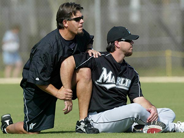 Florida Marlins pitcher Josh Beckett works with strength and conditioing director Paul Fournier during batting practice Tuesday, Feb. 22, 2005, at spring training, in Jupiter, Fla. (AP Photo/Rick Bowmer)