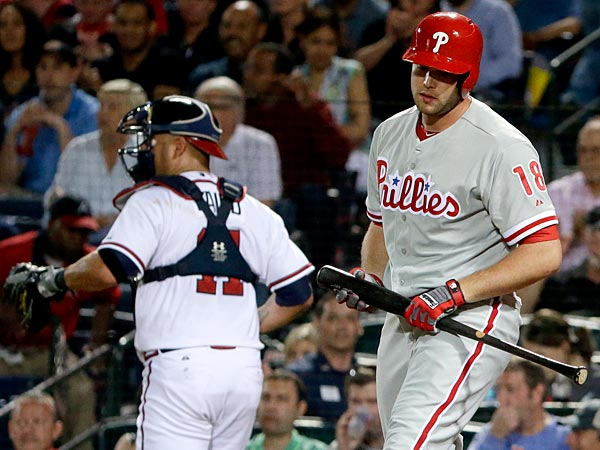 Philadelphia Phillies´ Darin Ruf, right, strikes out as Atlanta Braves catcher Gerald Laird returns to the dugout in the fifth inning of a baseball game, Thursday, Sept. 26, 2013, in Atlanta. (AP Photo/David Goldman)