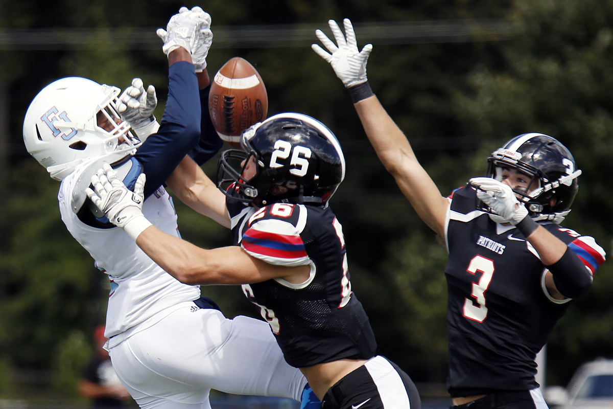 Germantown Academy defensive back Gunnar Bogorowski (26) breaks up a pass intended for Father Judge&acute;s Steve Arrington as Patriots teammate Mike Reilly (3) helps out during the first quarter of a nonleague football game Saturday, Sept. 9, 2017 at GA. The host Patriots went on to win, 21-20, in overtime. <br />