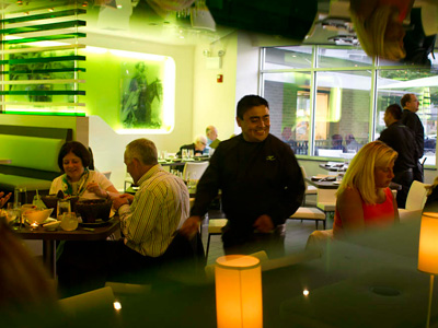 Bathed in green, the dining room of Xilantro in Wayne. (David M Warren / Staff Photographer)