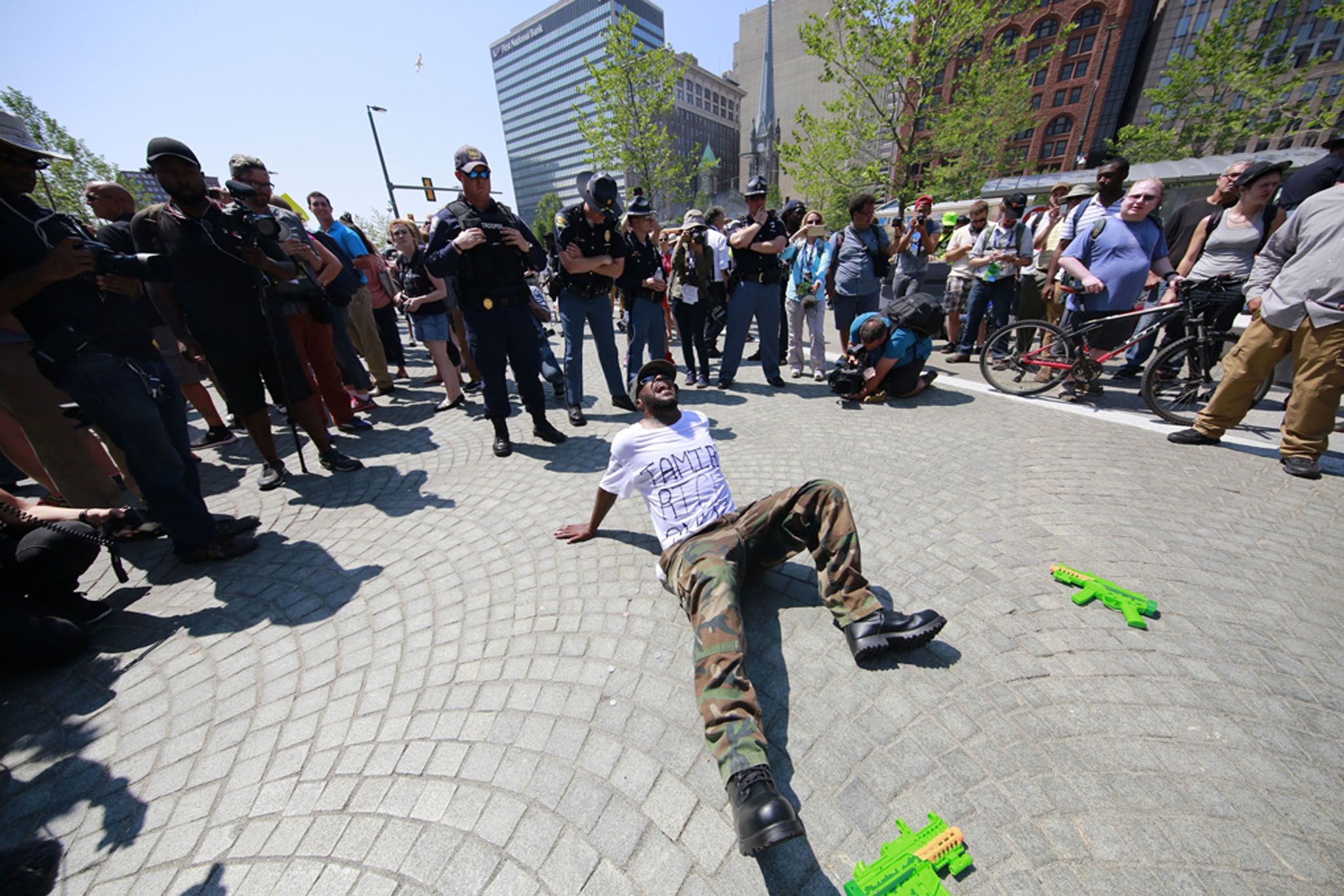 A protester acts out the killing of Tamir Rice in the Public Square during the RNC in Cleveland, Ohio on Tuesday, July 19, 2016.