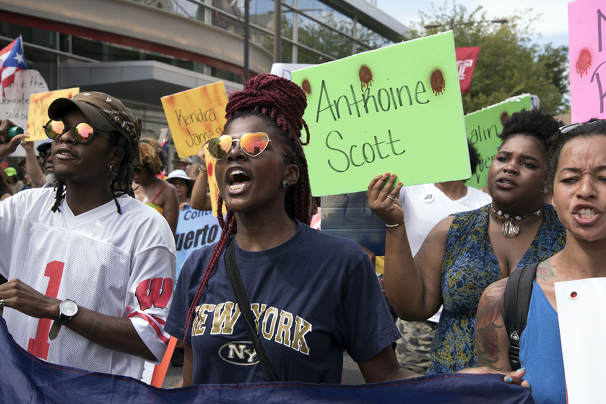 Emotions are high as protesters march down Broad street to protest against police-involved shootings of unarmed black men, and other racial issues on Tuesday, July 26th, 2016. The protest is lead by Philadelphia REAL Coalition and Black Lives Matter. It also is taking place during the second day of the DNC. AARON RICKETTS / Staff Photographer
