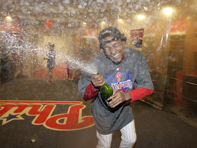 Pedro Martinez celebrates in the clubhouse last night after the Phillies beat the Houston Astros for the NL East crown.  (Yong Kim / Staff Photographer)