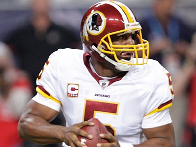 Charles Barkley will sport a Donovan McNabb Redskins jersey to Sunday´s game. (AP Photo / Tom Gannam)