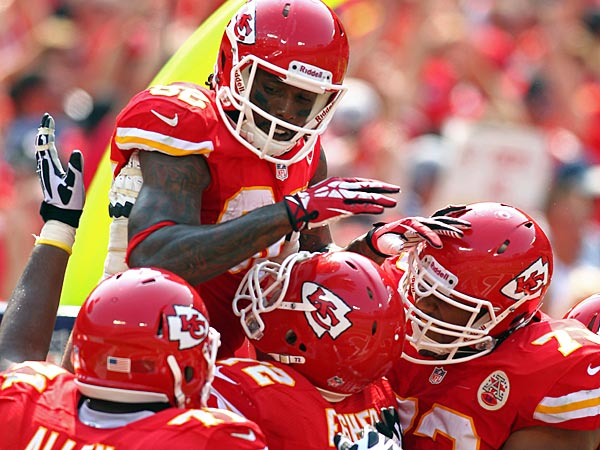 Kansas City Chiefs wide receiver Dwayne Bowe (82) celebrates with teammates after scoring a touchdown during an NFL game against the Dallas Cowboys on Sunday Sept. 15, 2013 at Arrowhead Stadium in Kansas City, MO. (AP Photo/TUSP, Jay Biggerstaff)