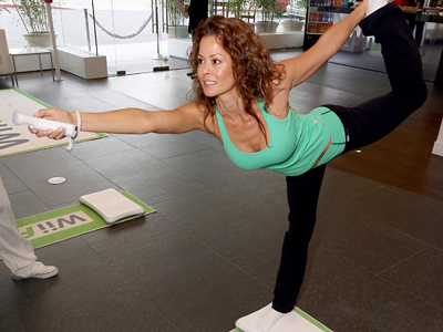 In this Sept. 29, 2009 photo released by Nintendo, TV personality Brooke Burke strikes a yoga pose at the Wii Fit Plus Fitness Club in West Hollywood, Calif. (AP Photo/Nintendo, Casey Rodgers)<br />