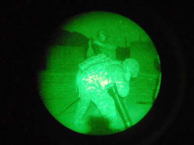 Seen through night vision goggles, artillerymen fire mortar shells in the direction of where the Taliban fires rockets outside Forward Operating Base Kala Gush. (Matt Katz / Staff)