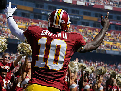 Robert Griffin III leads all fantasy scorers with a quarter of the season in the books. (Evan Vucci/AP)