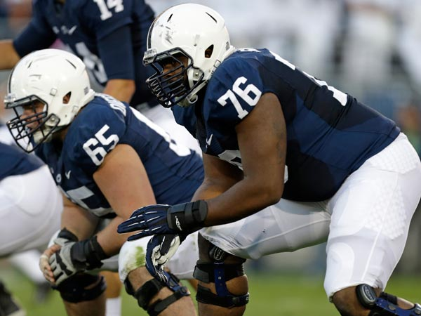 Penn State guard Miles Dieffenbach (65) and offensive tackle Donovan Smith (76) line up against Central Florida during the first quarter of an NCAA college football game against UCF in State College, Pa., Saturday, Sept. 14, 2013. UCF won 34-31. (Gene J. Puskar/AP)