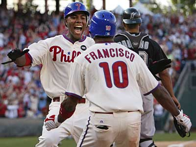 John Mayberry Jr. is greeted by Ben Francisco after scoring the game-winning run in the Phillies´ extra-inning win over the Marlins. (Ron Cortes / Staff Photographer)