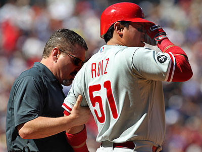 Carlos Ruiz left Sunday´s game after being hit in the elbow by Atlanta´s Tim Hudson. (John Bazemore/AP)
