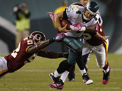 Kevin Kolb tries to scramble in the fourth quarter on Sunday against the Redskins. (Ron Cortes / Staff Photographer)