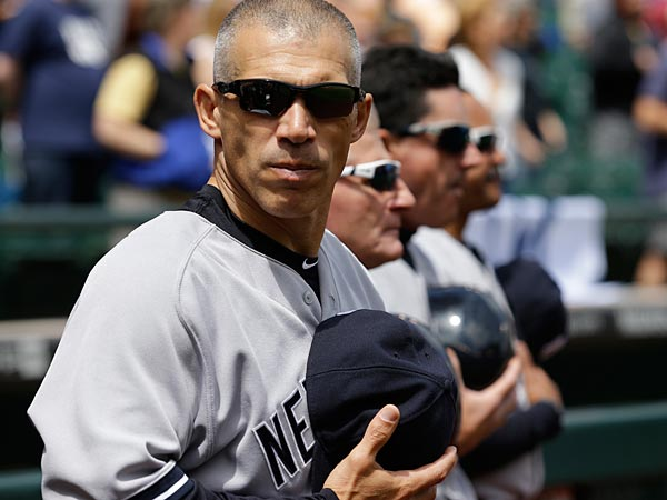 New York Yankees manager Joe Girardi stands during the national anthem before a baseball game against the Seattle Mariners, Sunday, June 9, 2013, in Seattle. (AP Photo/Ted S. Warren)
