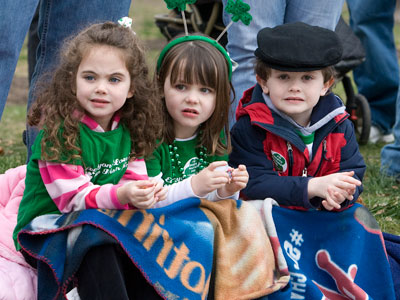 Triplets from left Ciara, Corinne, Christopher Lacey, 4, watch the St. Patrick´s day parade last March. (Akira Suwa / Staff Photographer )