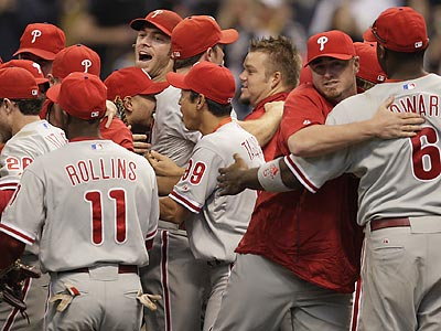 Phillies players charge the mound to celebrate their NLDS-clinching 6-2 win over Milwaukee. (David Maialetti/Staff Photographer) &lt;b&gt;&lt;a href=&quot;http://www.philly.com/inquirer/photography/sports_photos/Phillies_Advance.html&quot;&gt;More photos&lt;/a&gt;&lt;/b&gt;<br />
