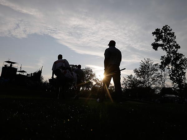 United States´ Tiger Woods walks to the ninth green during a foursome match against the International team at the Presidents Cup golf tournament. (AP Photo/Darron Cummings)