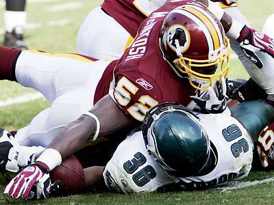 Redskins linebacker Rocky McIntosh tackles Brian Westbrook during the Eagles´ 23-17 loss. Westbrook fractured two ribs in the first quarter.  (Tom Mihalek/AP Photo)
