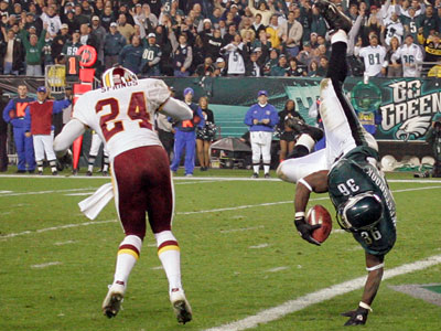 Brian Westbrook flies through the air to score a 14-yard touchdown Sunday in the fourth quarter and after fracturing two ribs in the first quarter. (Jerry Lodriguss / Staff Photographer)