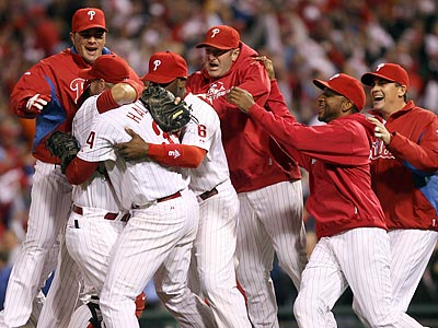 Phillies players rush to celebrate with Roy Halladay after his no-hitter. (Yong Kim / Staff Photographer)